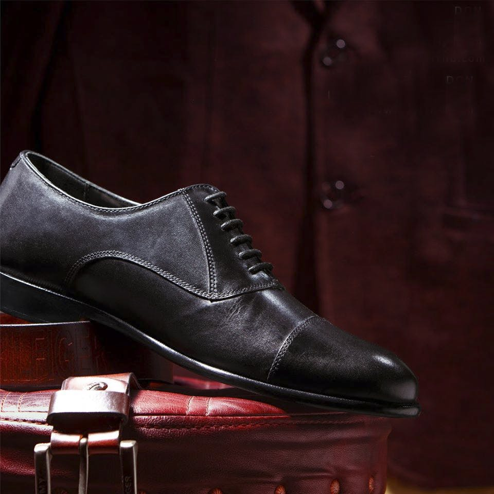 Footwear,Shoe,Brown,Dress shoe,Oxford shoe,Still life photography,Leather,Still life,Athletic shoe,Brand
