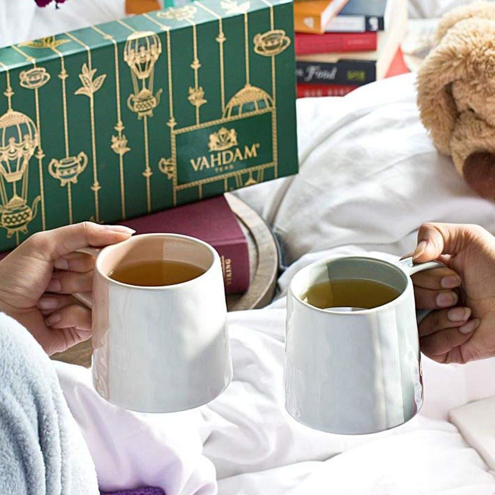 Coffee cup,Hand,Table,Cup,Cup,Textile,Tableware,Drinkware,Mug,Interior design
