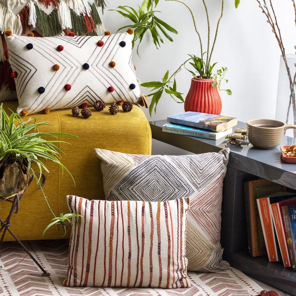 Cushion,Pillow,Throw pillow,Furniture,Bedding,Room,Interior design,Yellow,Textile,Couch