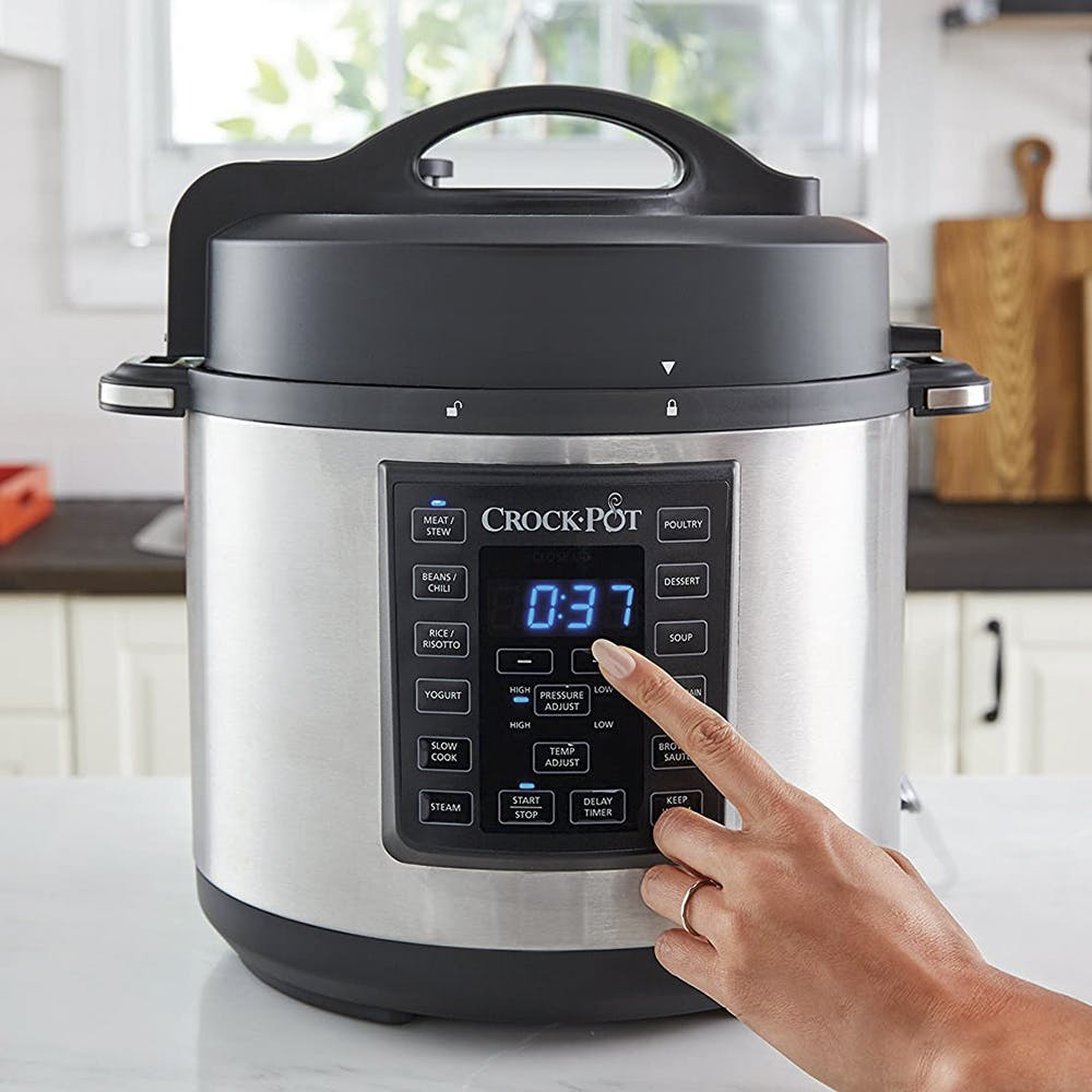 Rice cooker,Small appliance,Home appliance,Lid,Product,Cookware and bakeware,Pressure cooker,Kitchen appliance,Slow cooker,Food steamer
