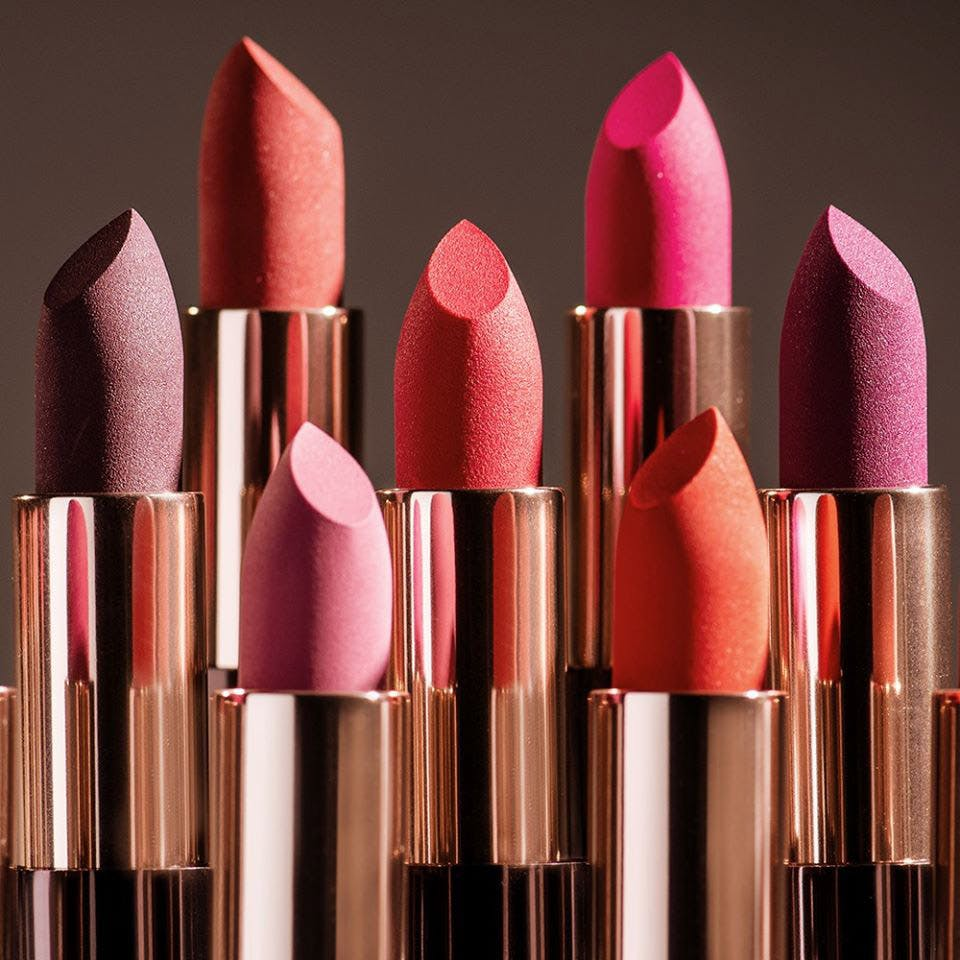 Pink,Lipstick,Cosmetics,Beauty,Lip,Tints and shades,Material property,Magenta,Carmine,Still life photography