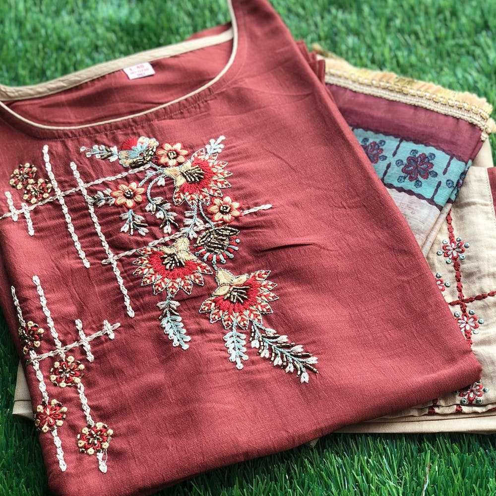Clothing,Red,Maroon,Needlework,Textile,Pattern,Embroidery,Outerwear,Pattern,Woven fabric