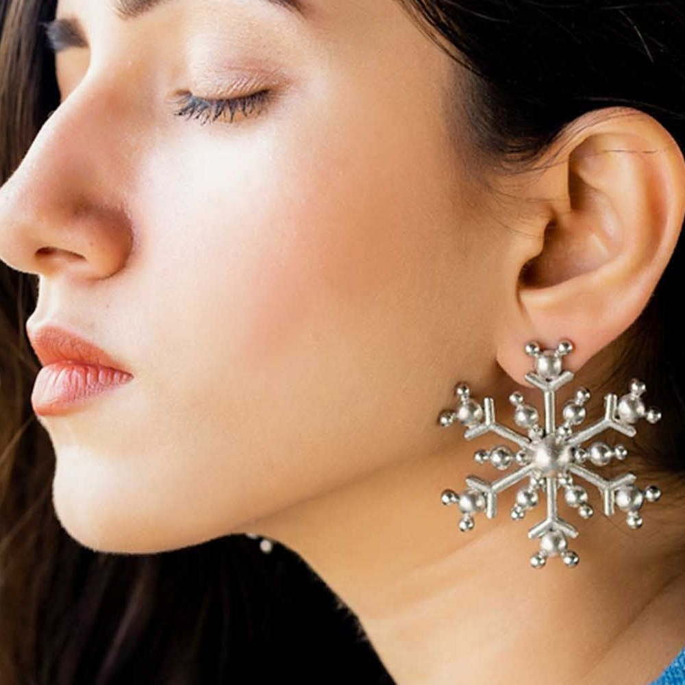 Face,Ear,Nose,Chin,Cheek,Earrings,Neck,Jewellery,Skin,Body jewelry