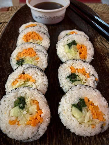 Dish,Food,Gimbap,Cuisine,Sushi,California roll,Ingredient,White rice,Steamed rice,Comfort food