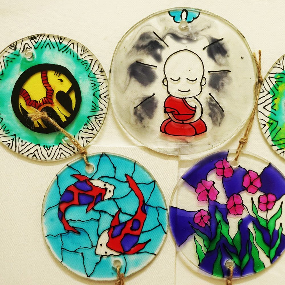 Glass,Stained glass,Illustration,Window,Fashion accessory,Plate,Fictional character,Circle,Ceramic,Pin-back button