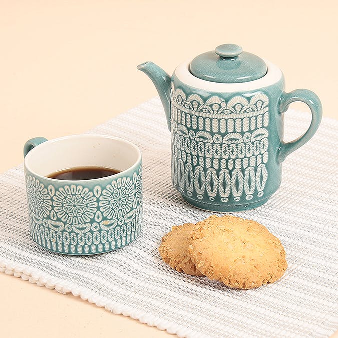 Coffee cup,Serveware,Cup,Cup,Teapot,Tableware,Porcelain,Drinkware,Saucer,Turquoise