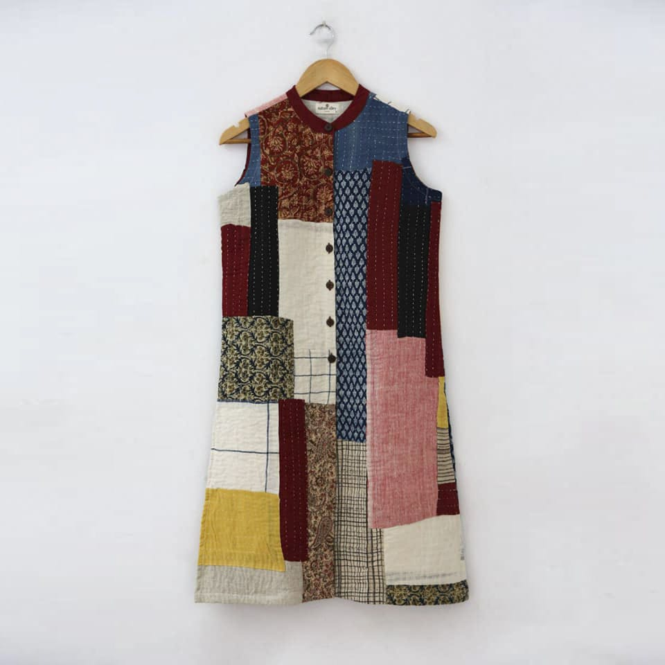 Clothing,Outerwear,Maroon,Patchwork,Brown,Textile,Pattern,Woven fabric,Sleeve,Beige