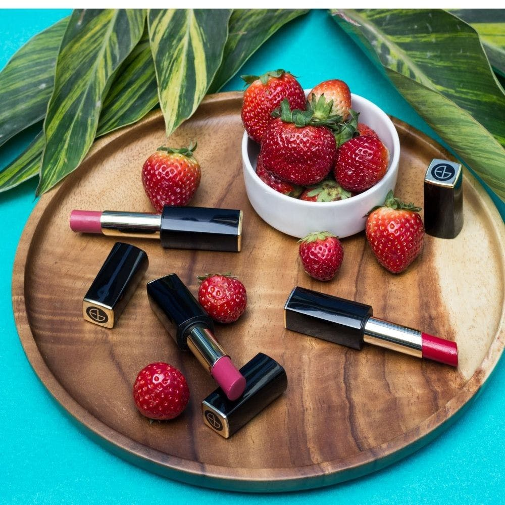 Fruit,Food,Berry,Strawberry,Plant,Material property,Cosmetics,Lip gloss,Strawberries,Produce