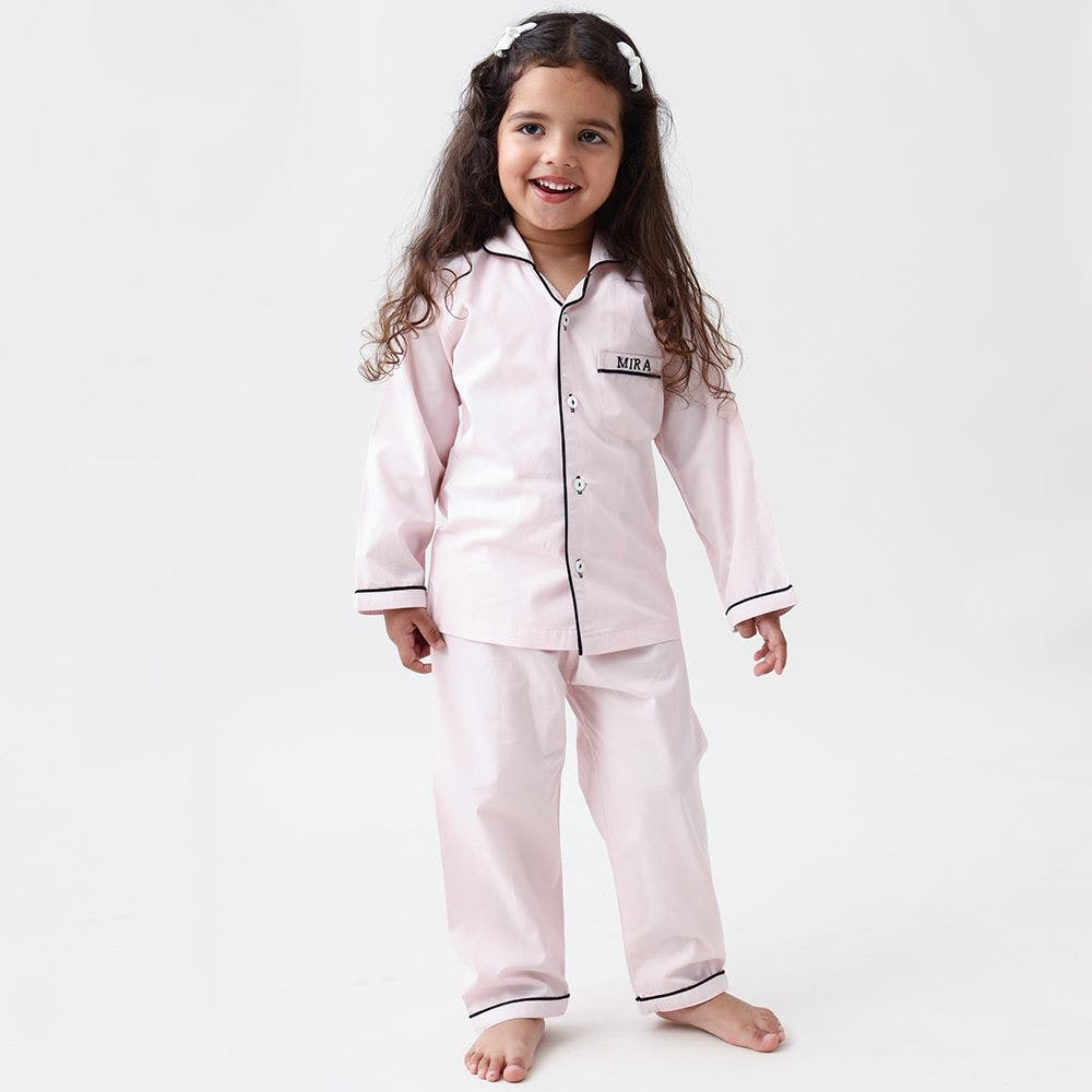 Clothing,White,Nightwear,Uniform,Pajamas,Outerwear,Robe,Suit,Sleeve,Child