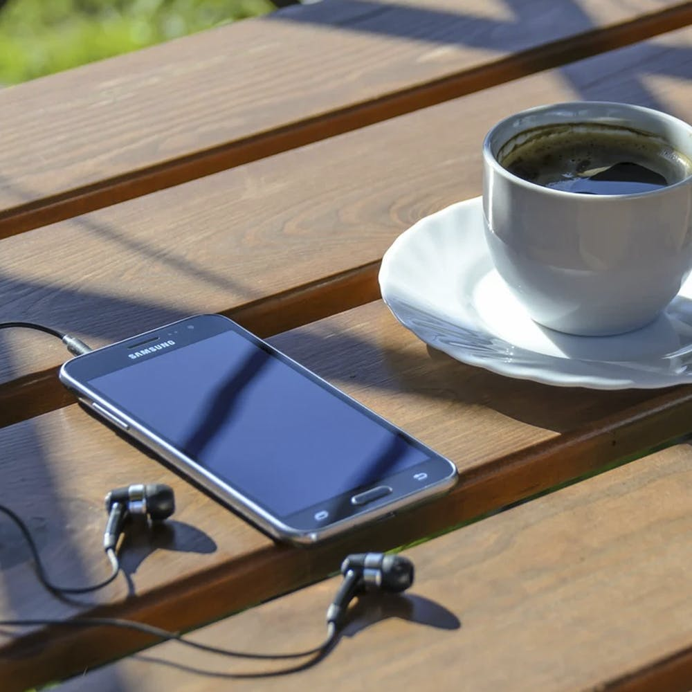 Gadget,Coffee cup,Table,Technology,Cup,Tray,Electronic device,Tableware,Desk,Wood