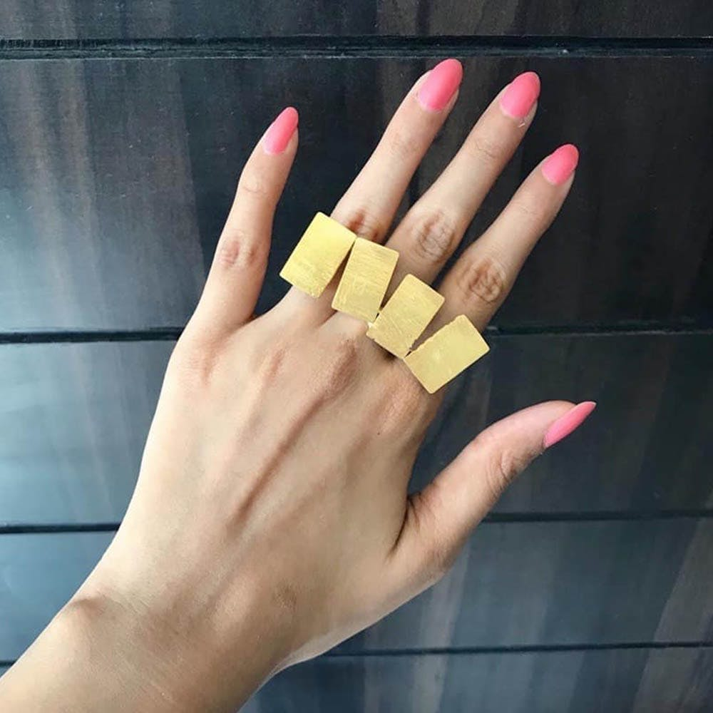 Finger,Nail,Hand,Yellow,Thumb,Gesture,Material property,Ring,Wrist,Fashion accessory
