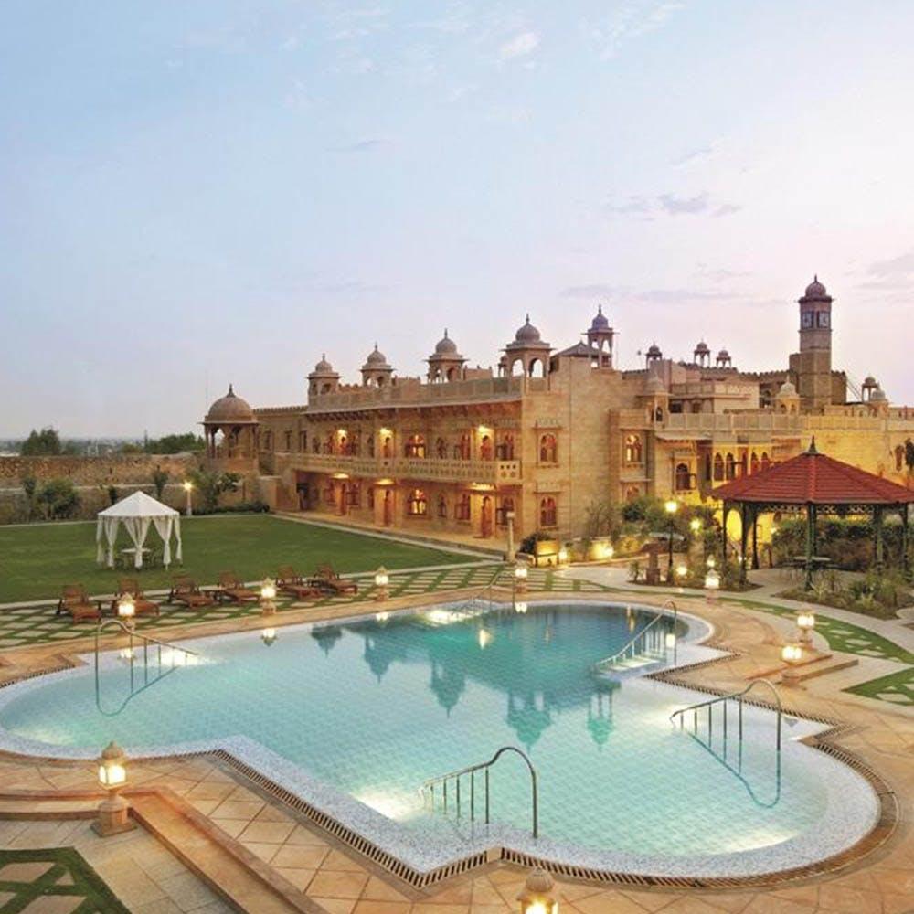 Swimming pool,Resort,Property,Building,Estate,Town,Real estate,Resort town,Sky,Water