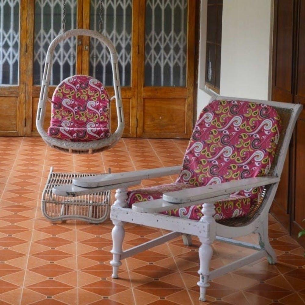 Furniture,Chair,Rocking chair,Room,Floor,Interior design,Flooring,Hardwood,Wood,House