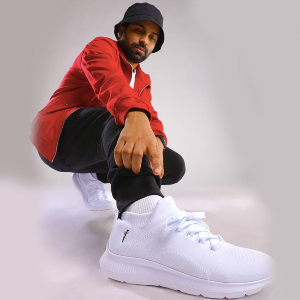 Footwear,White,Shoe,Sportswear,Sneakers,Athletic shoe,Sitting,Outdoor shoe
