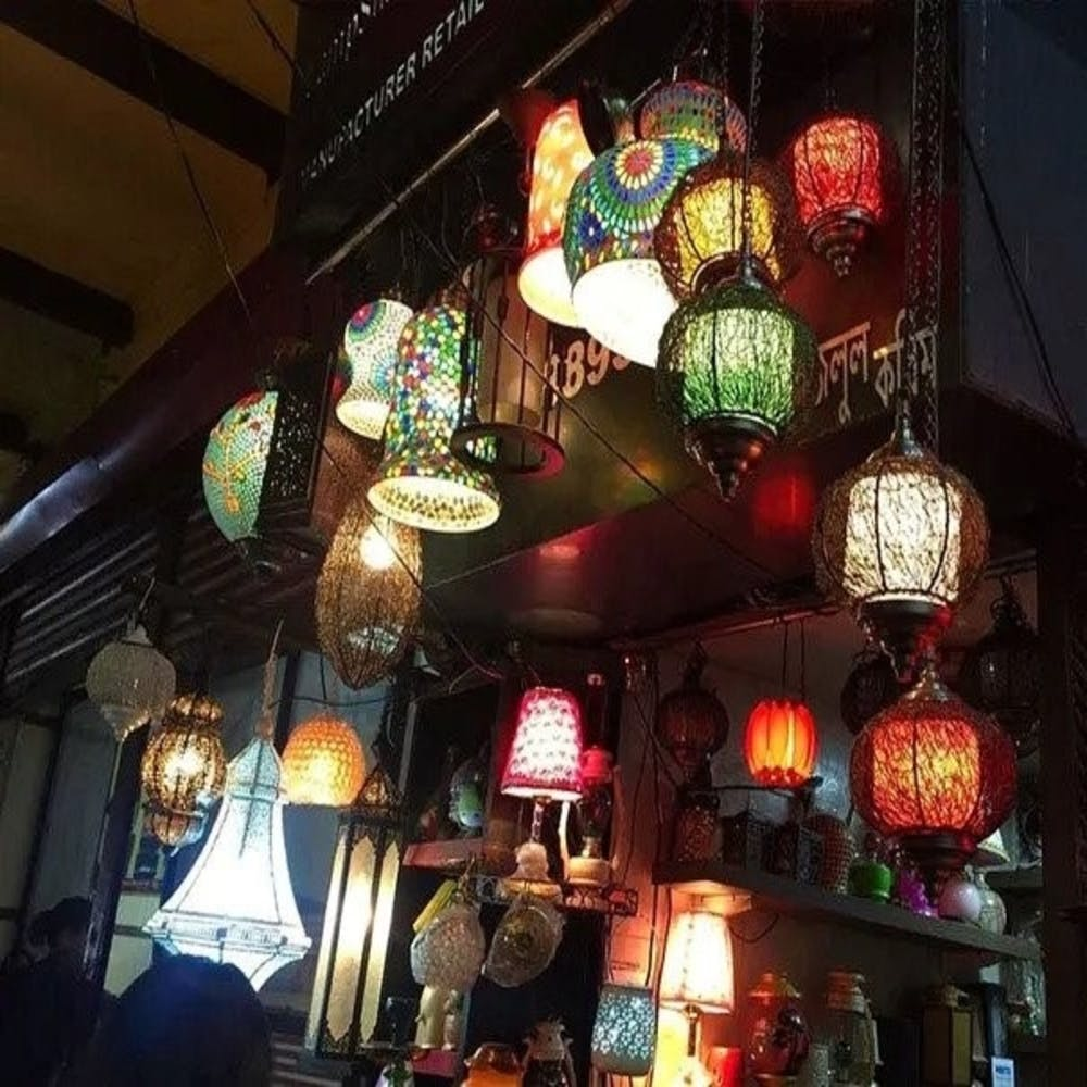 Market,Lighting,Public space,Bazaar,City,Lighting accessory,Building,Night,Lantern