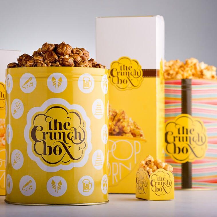 Popcorn,Kettle corn,Snack,Caramel corn,Food,Yellow,Font,Cuisine,Vegetarian food,Paper bag