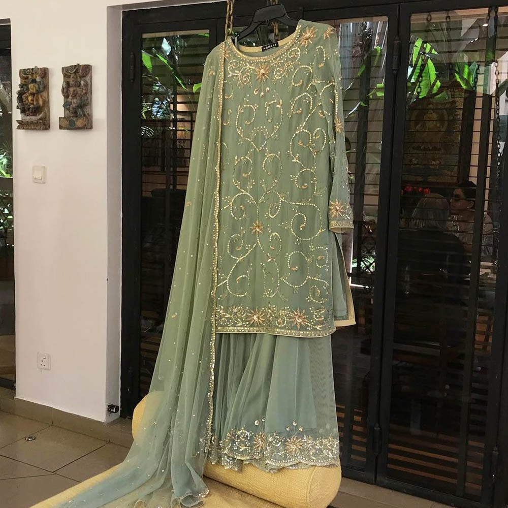 Clothing,Formal wear,Dress,Boutique,Gown,Fashion,Fashion design,Textile,Haute couture,Embroidery