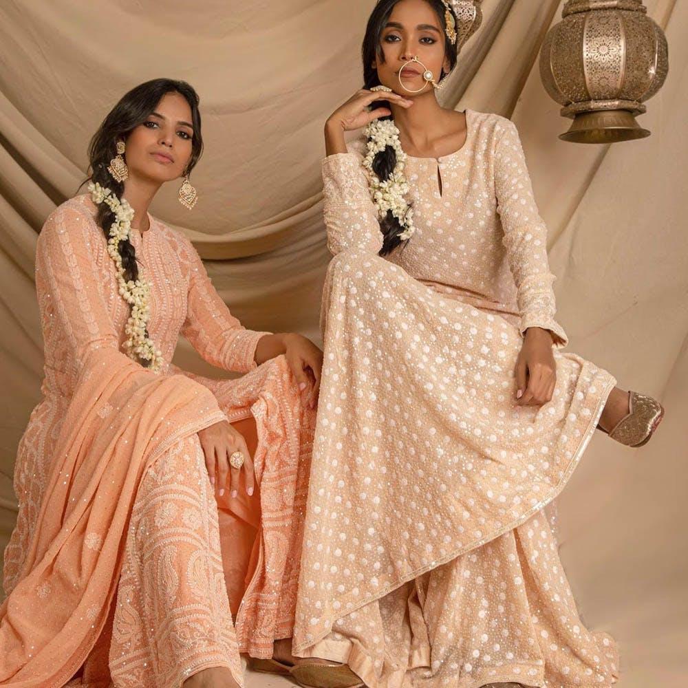 Clothing,White,Formal wear,Sari,Dress,Fashion model,Pink,Peach,Fashion,Fashion design