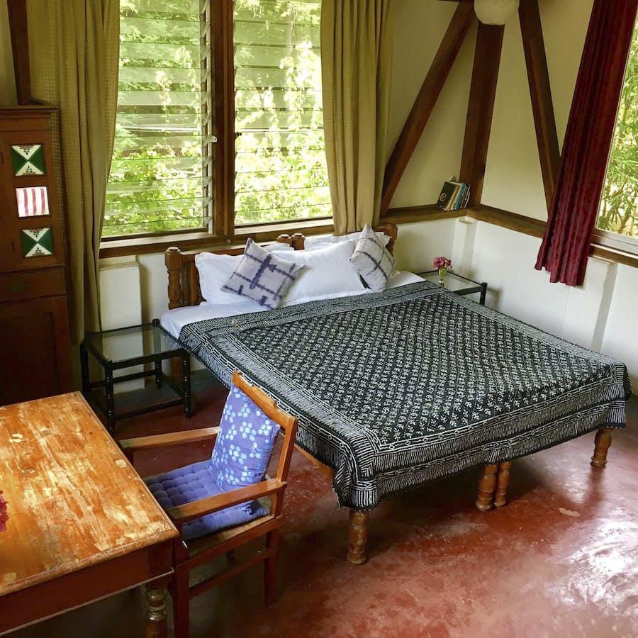 Furniture,Room,Property,Bed frame,Floor,Bed sheet,Bedroom,Interior design,Bedding,Hardwood