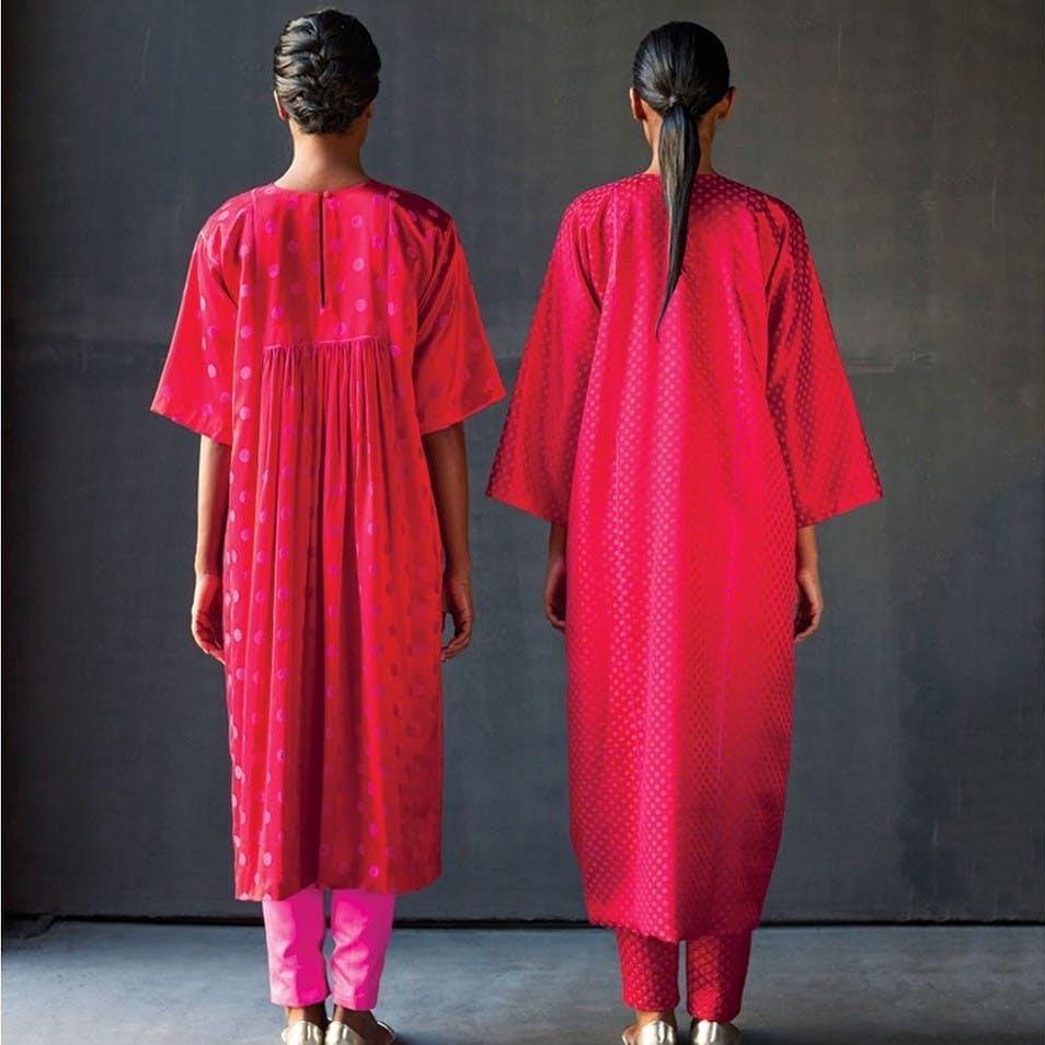 Clothing,Pink,Robe,Outerwear,Formal wear,Fashion,Nightwear,Costume,Dress,Textile