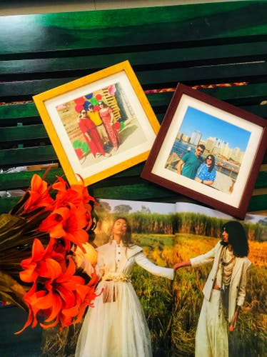 Photograph,Picture frame,Yellow,Art,Room,Photography,Painting,Dress,Plant