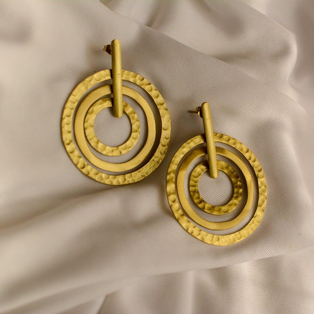 Earrings,Yellow,Jewellery,Fashion accessory,Metal,Body jewelry,Spiral,Brass,Gold