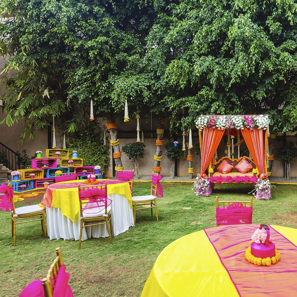 Decoration,Pink,Backyard,Party,Event,Chair,Grass,Function hall,Tree,Table