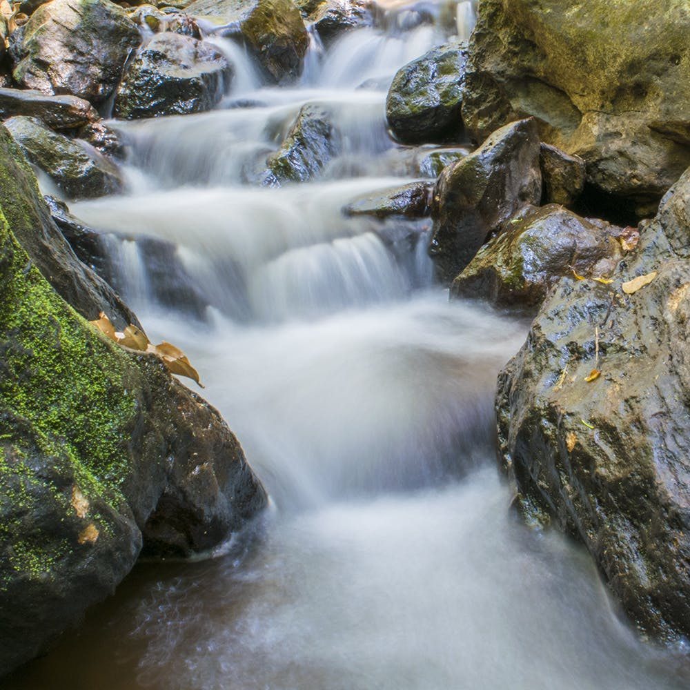 Waterfall,Body of water,Water resources,Natural landscape,Water,Nature,Stream,Watercourse,Rock,Nature reserve