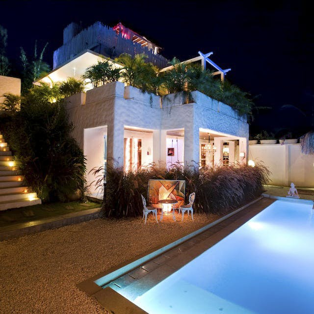 Property,Home,House,Lighting,Real estate,Building,Light,Landscape lighting,Swimming pool,Residential area