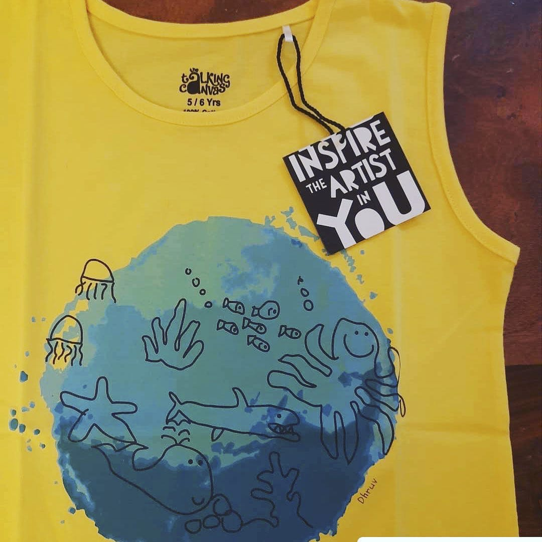 Clothing,Blue,Yellow,T-shirt,Product,Baby & toddler clothing,Sleeveless shirt,Outerwear,Font,Active tank