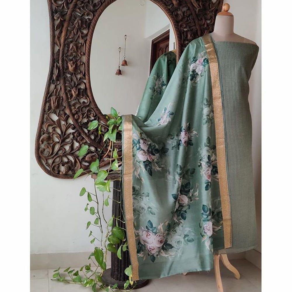 Green,Clothing,Turquoise,Aqua,Textile,Dress,Furniture,Outerwear,Plant,Fashion accessory