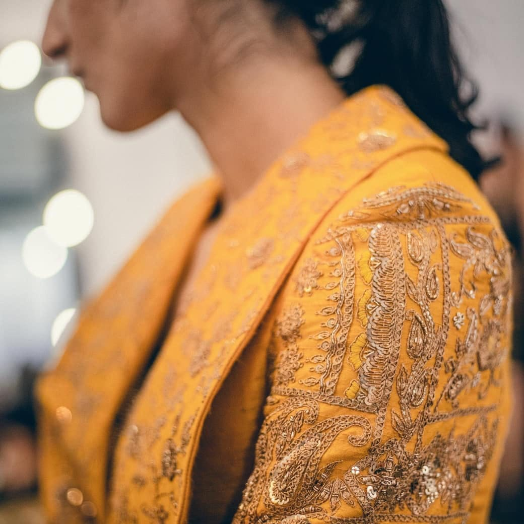 Yellow,Shoulder,Outerwear,Design,Textile,Neck,Pattern,Photography,Tradition,Fashion accessory