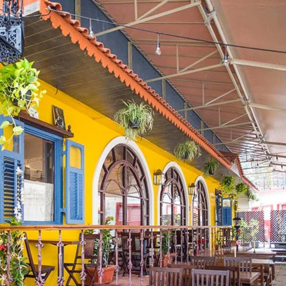 Building,Yellow,Real estate,Architecture,House,Restaurant,Facade