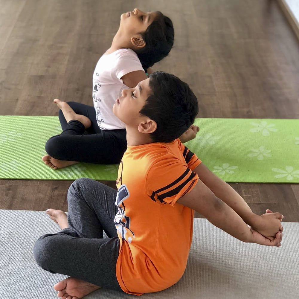 Physical fitness,Yoga,Shoulder,Joint,Sitting,Leg,Child,Contact sport,Individual sports,Yoga mat