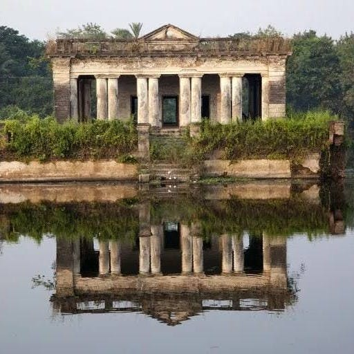 Reflection,Water,Architecture,Reflecting pool,Historic site,Ruins,Building,Sky,Temple,Ancient roman architecture