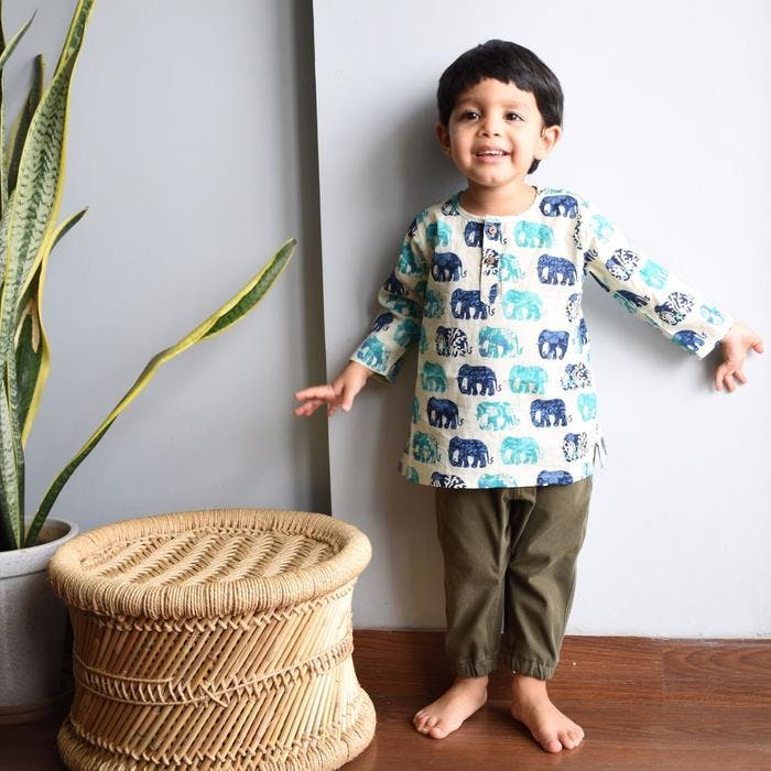 Child,Wool,Furniture,Outerwear,Room,Textile,Plant,Wicker,Toddler,Sweater