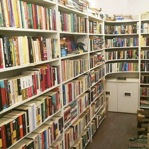 Bookcase,Shelving,Library,Shelf,Public library,Bookselling,Furniture,Book,Building,Publication