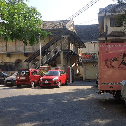 Vehicle,Transport,Car,Red,Mode of transport,Town,House,Neighbourhood,Luxury vehicle,Road