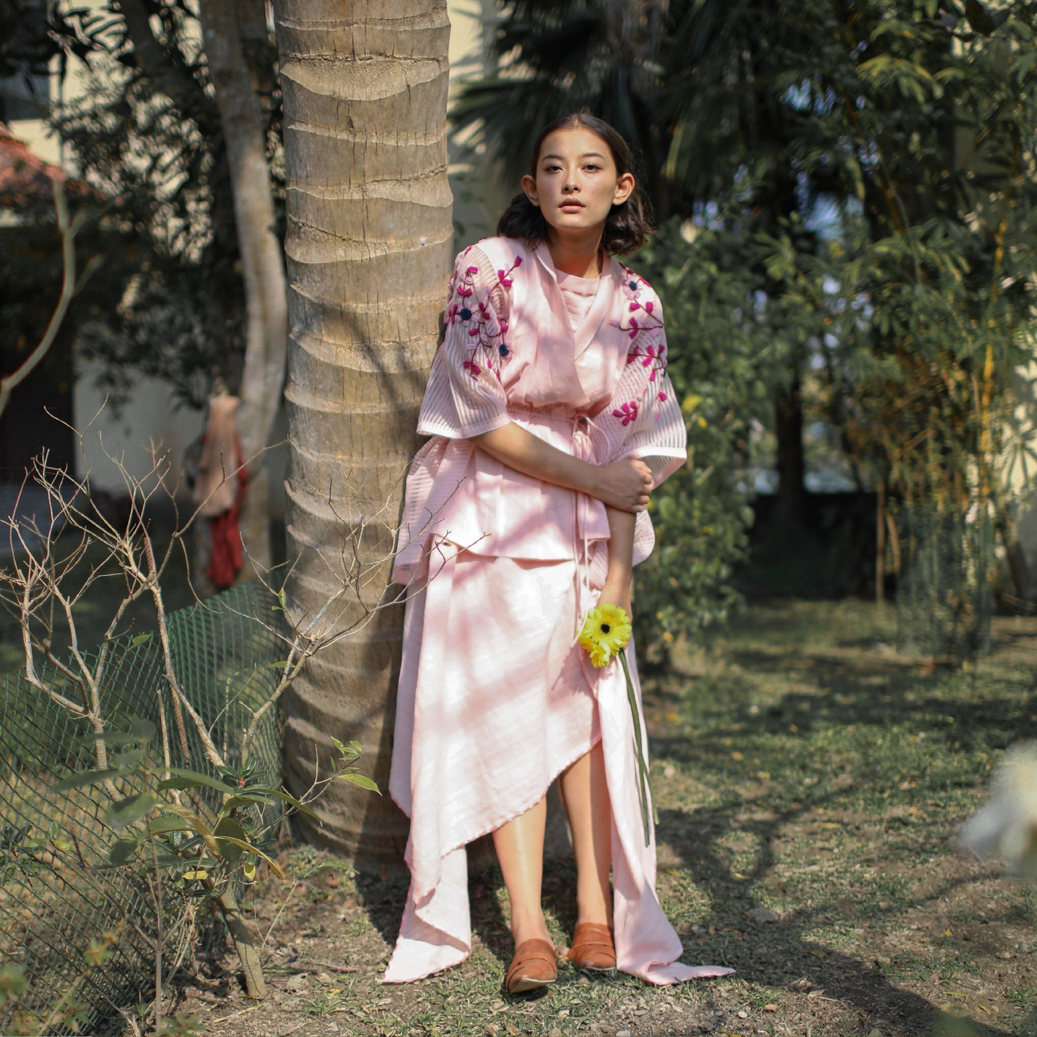 People in nature,Long hair,Peach,Sandal,Wire fencing,Day dress,Mesh,One-piece garment