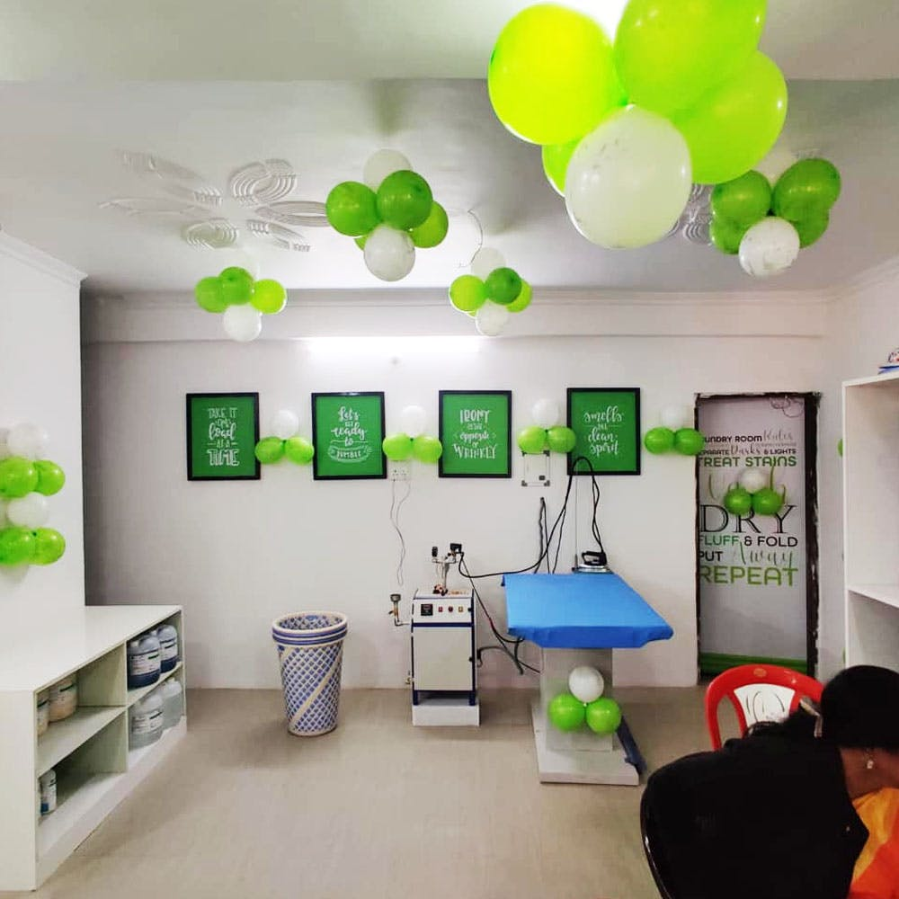 Green,Room,Interior design,Balloon,Wall,Hat,Party supply,Floor,Ceiling,Turquoise