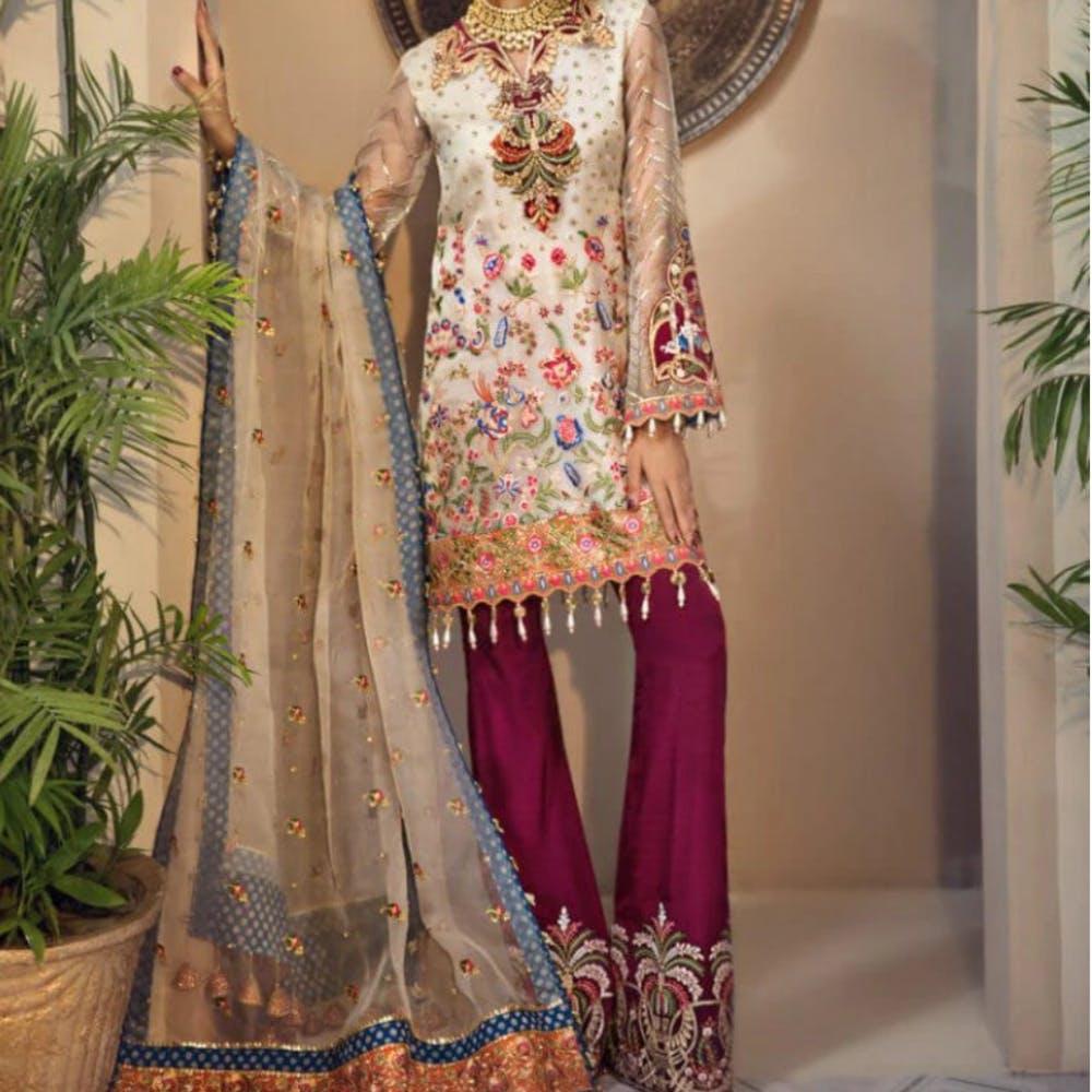 Textile,Flowerpot,Embroidery,Houseplant,One-piece garment,Day dress,Embellishment,Costume,Sun hat,Fashion design