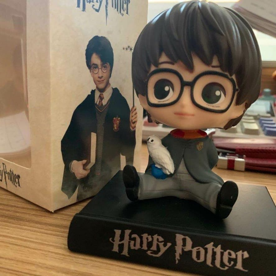 Toy,Black hair,Bangs,Fiction,Action figure,Animation,Fictional character,Figurine,Publication,Collectable