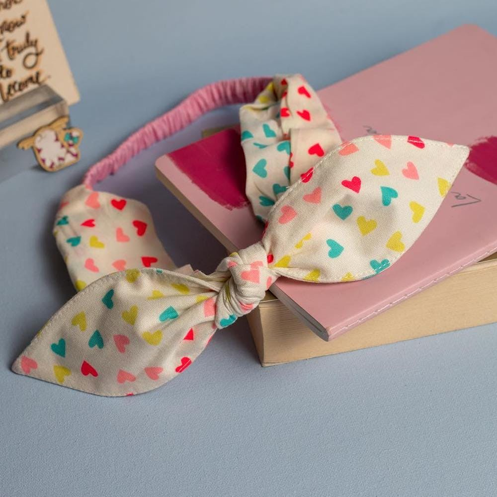 Ribbon,Pink,Pattern,Party supply,Paper product,Party favor,Present,Knot,Paper,Confectionery