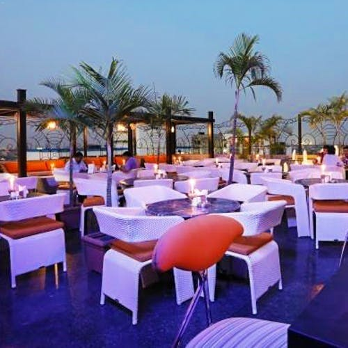 Property,Furniture,Table,Real estate,Outdoor furniture,Restaurant,Resort,Arecales,Linens,Function hall