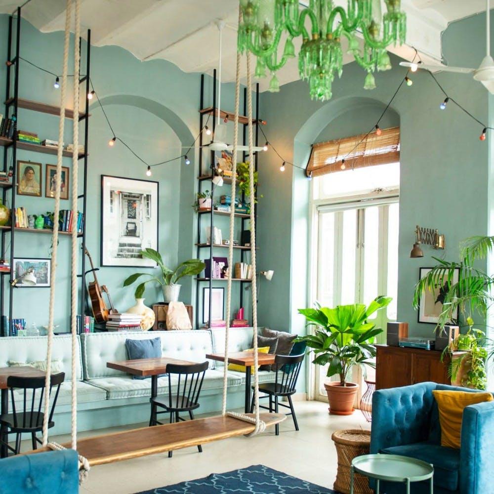 Green,Interior design,Room,Floor,Furniture,Table,Ceiling,Flowerpot,Light fixture,Turquoise