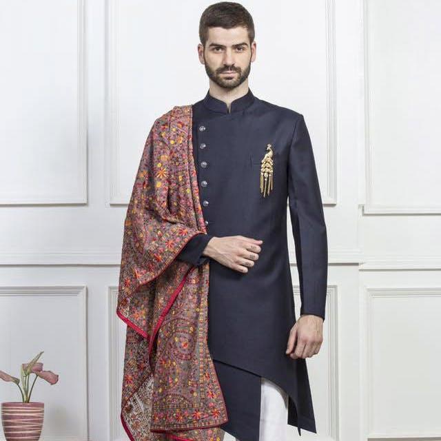 Flowerpot,Sleeve,Collar,Houseplant,Beard,Cloak,Mantle,Suit trousers,Clergy,Fashion design
