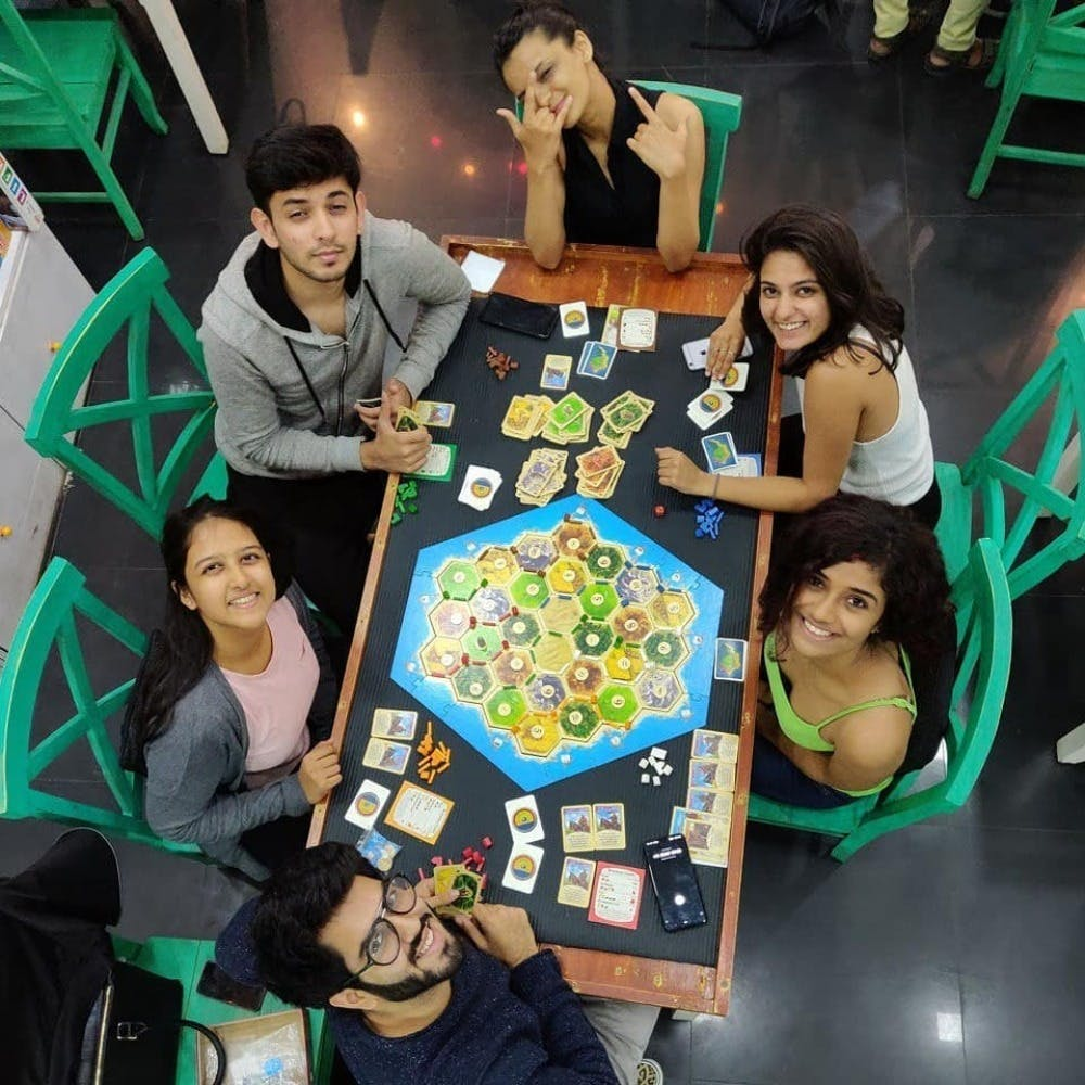 Face,Head,Fun,Indoor games and sports,Recreation,Leisure,Community,Tabletop game,Sharing,Friendship