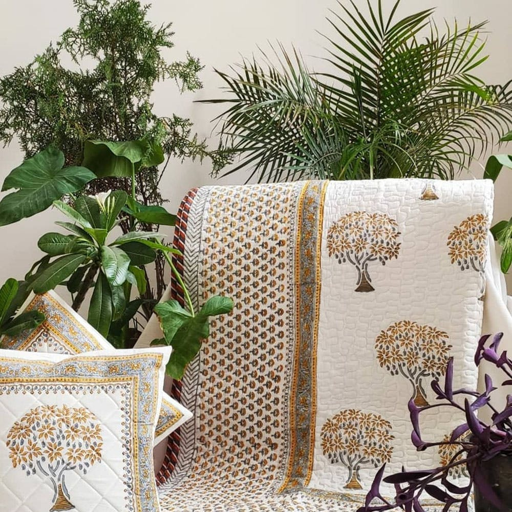 Textile,Linens,Home accessories,Creative arts,Cushion,Throw pillow,Floral design,Craft,Pillow,Bedding