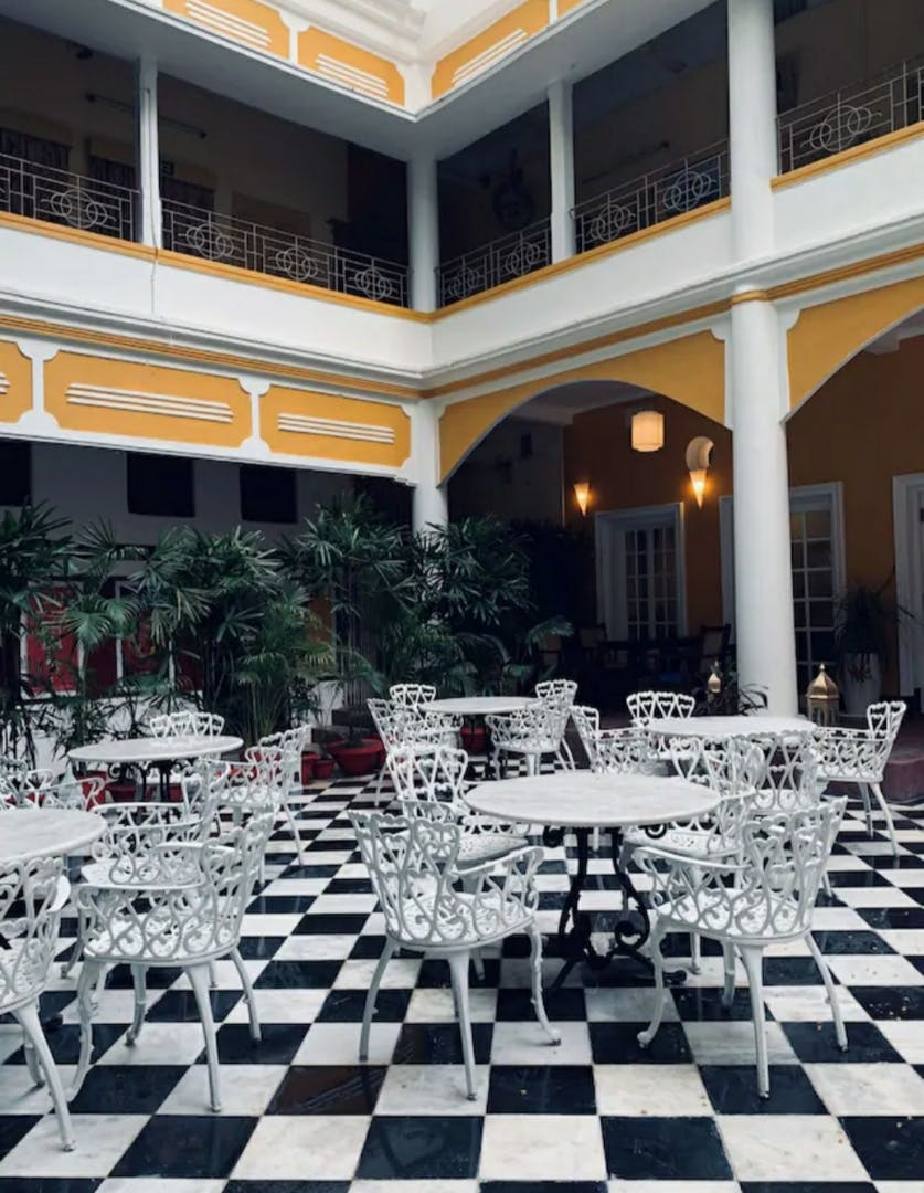 Games,Property,Building,Tile,Indoor games and sports,Courtyard,Floor,Architecture,Interior design,Recreation