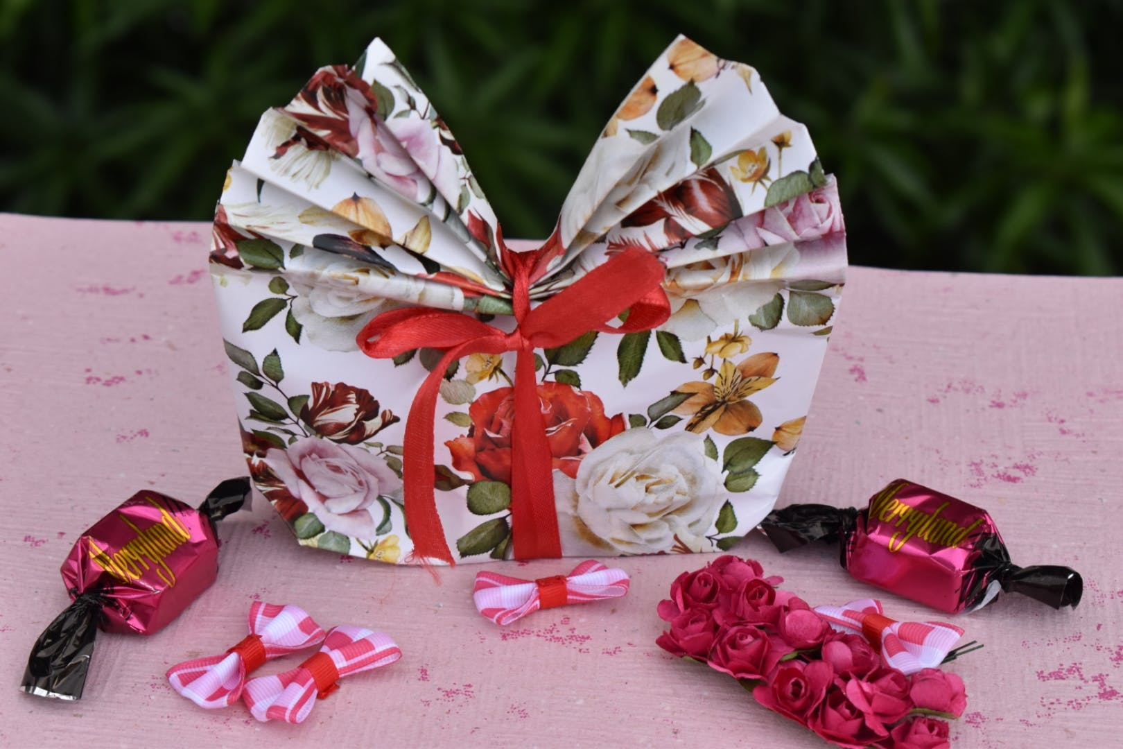 Pink,Butterfly,Party favor,Wedding favors,Paper,Present,Paper product,Fashion accessory,Moths and butterflies,Ribbon
